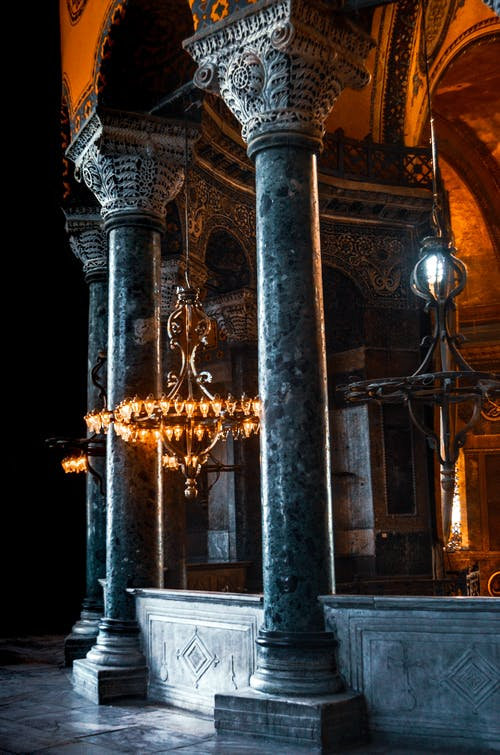 Old cathedral with ornamental columns and chandeliers