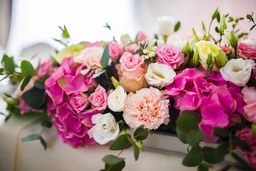 Bouquet of fresh flowers in white vessel