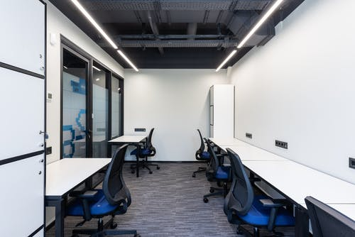 Modern workplace with chairs near tables