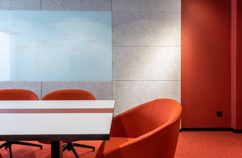 Table with chairs in conference room
