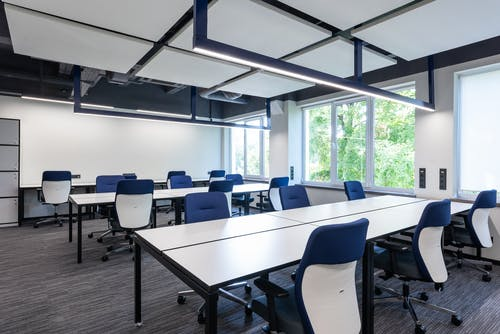 Contemporary office with chairs at desks