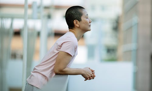 Asian woman with eyes closed suffering from breast cancer