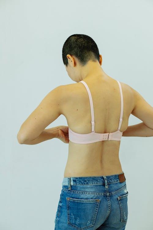Anonymous lady in bra in studio