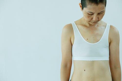 Woman in underwear standing in white studio