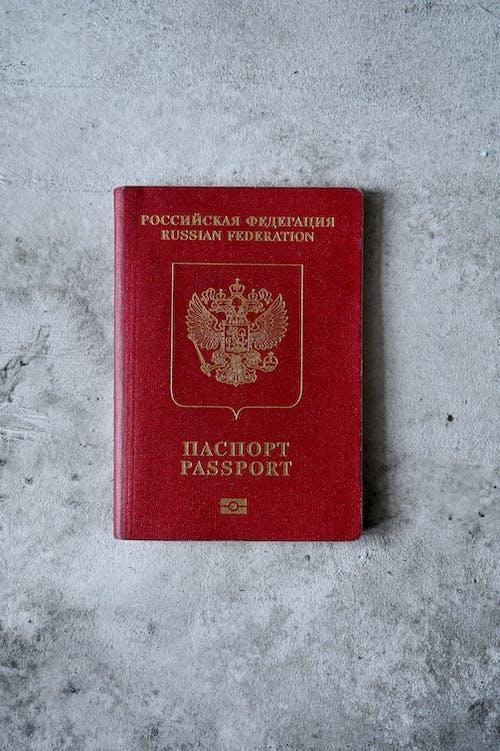 Overhead Shot of a Russian Passport on a Cement Surface