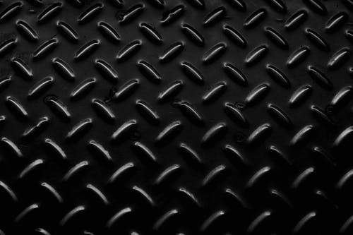 Metal seamless background with oval bulge