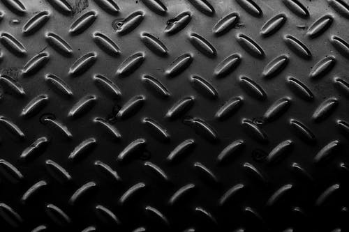 Textured background of metal surface with bulges