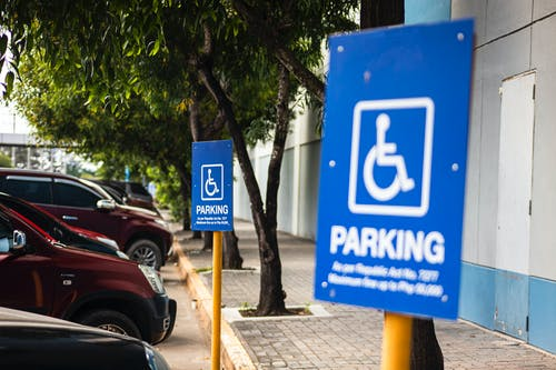 Disabled parking sign on street with transport
