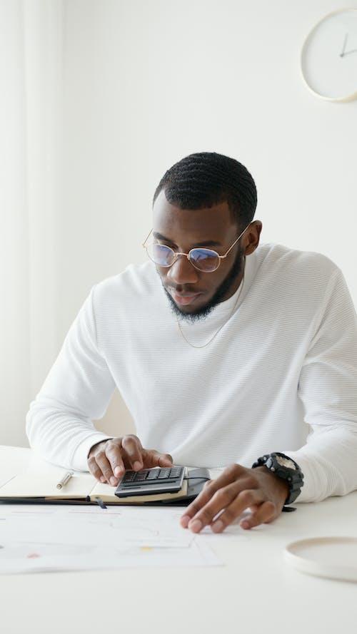 Photo Of Person Using Calculator