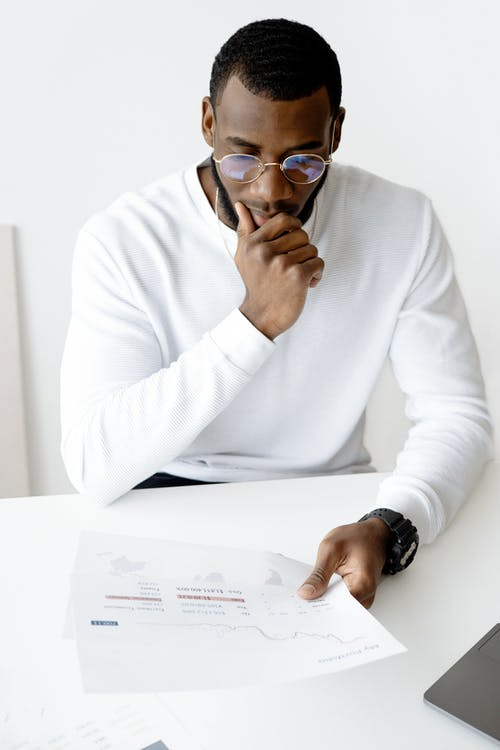 Photo Of Man Holding White Paper