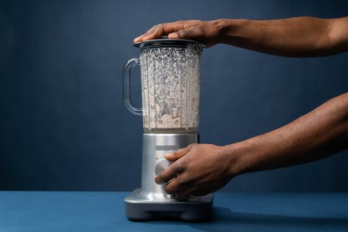 Person using a Blender