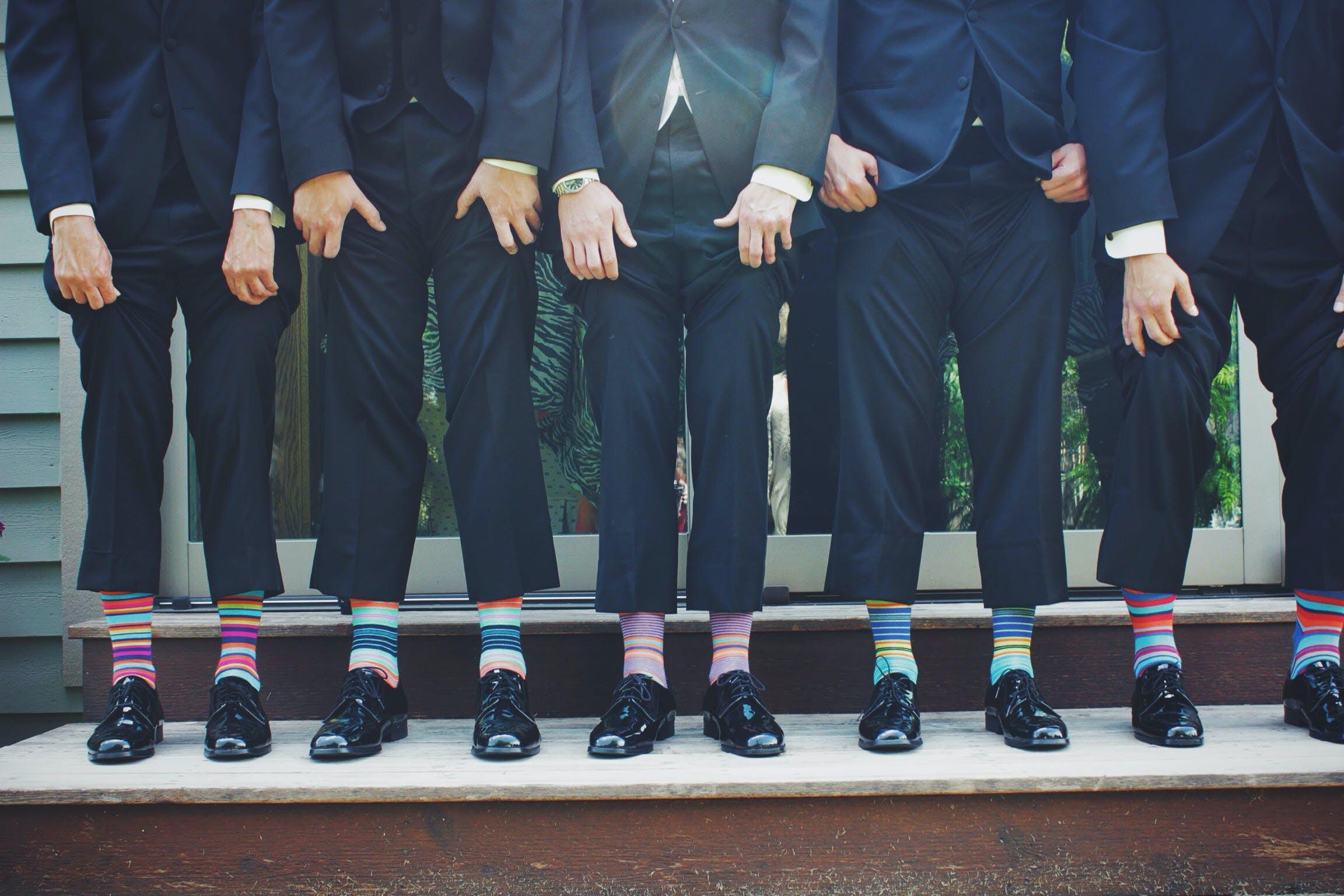 People Wearing Pair of Multicolored Socks