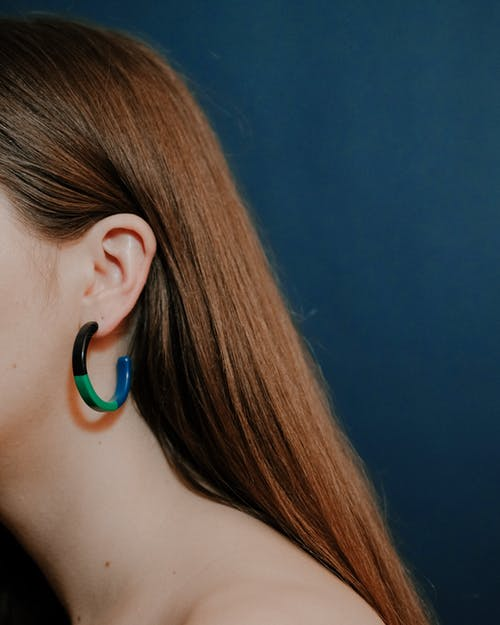 Anonymous female with colorful hoop earrings