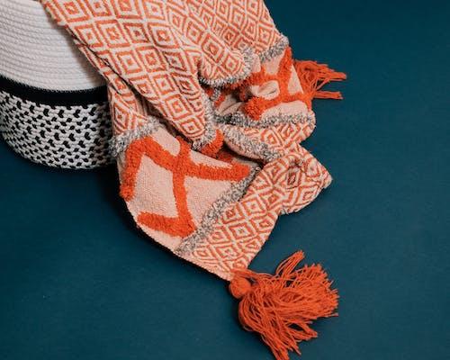 Traditional warm plaid in rattan basket