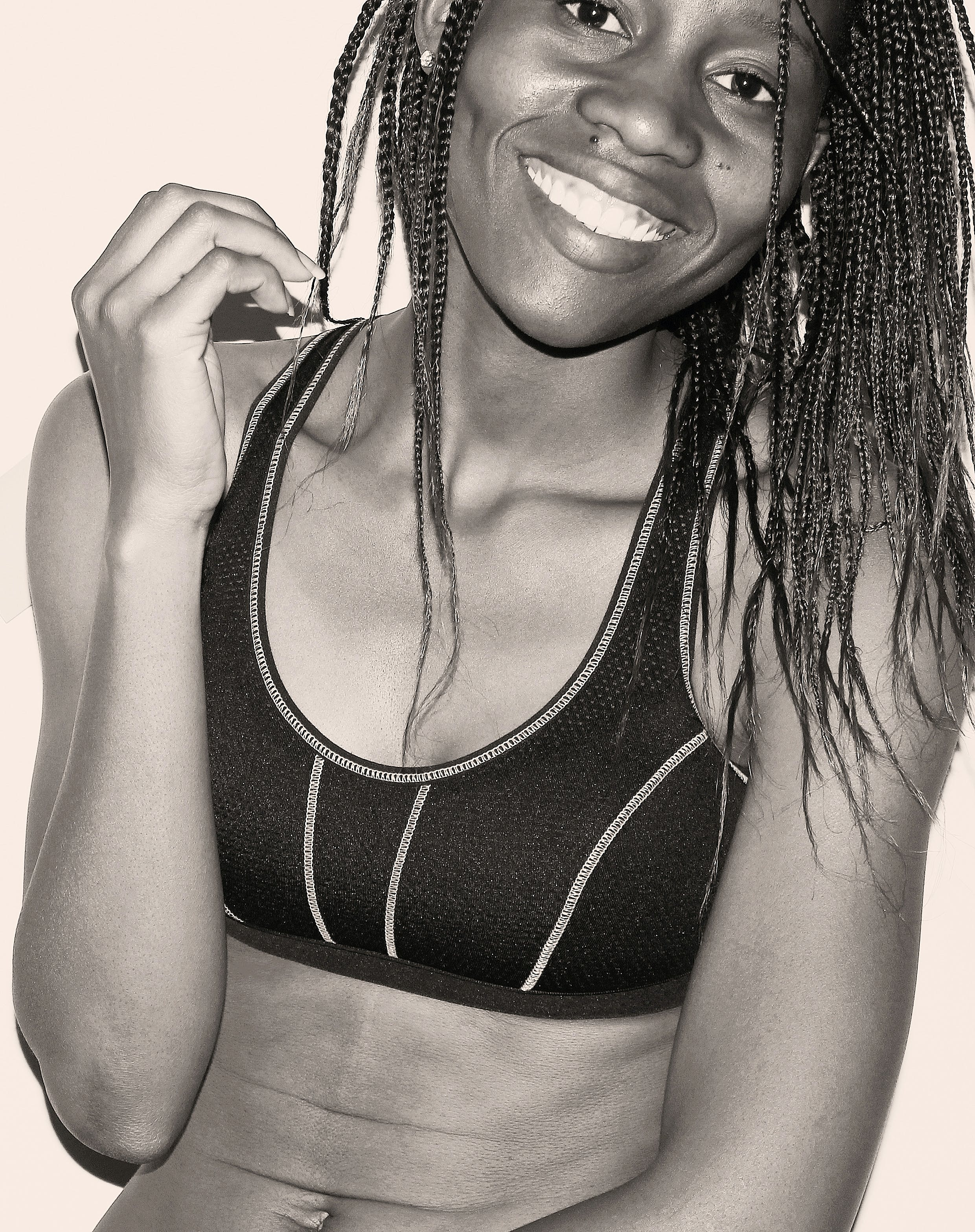 Woman in Sport Bra With Braided Hair Grayscale Photo