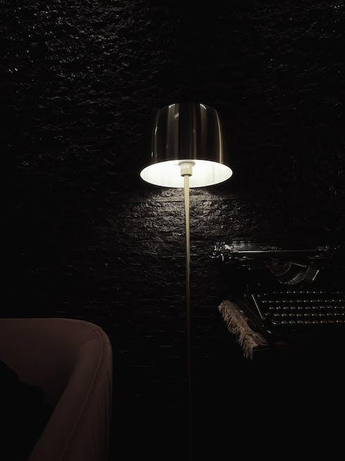 Luminous modern lamp near vintage typewriter