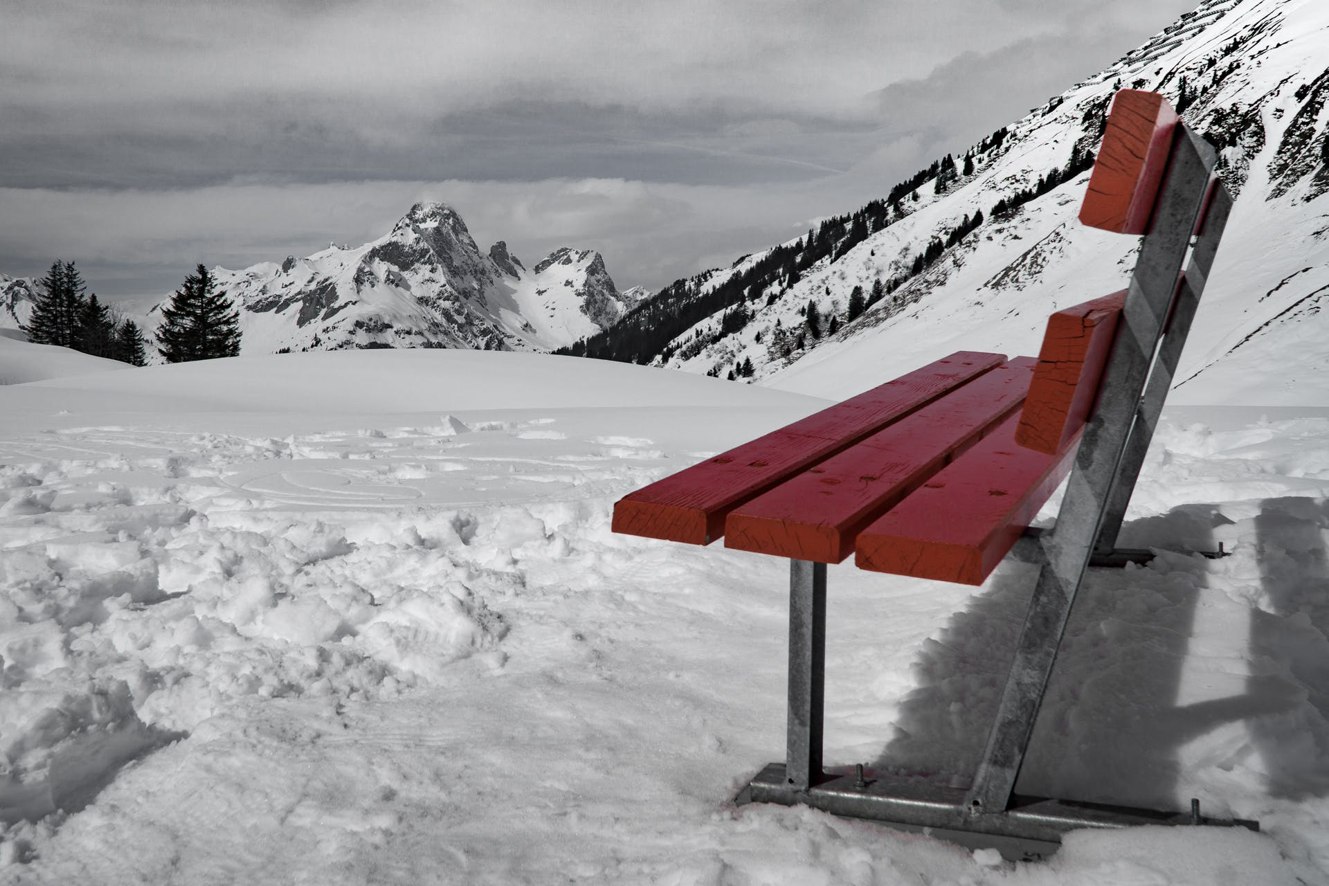 Grey and Brown Bench on Snow Near Mountain during Daytime
