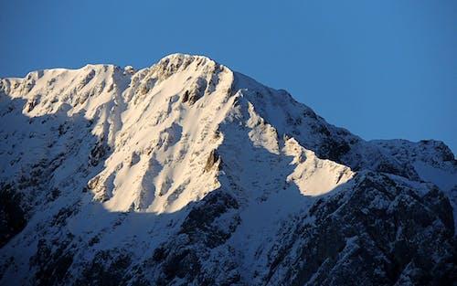 Free stock photo of mountain peaks, peak, snow capped mountains