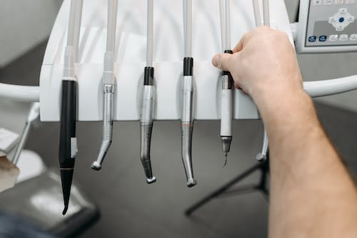 Person Holding Stainless Steel Hand Tool