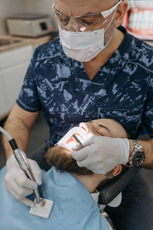 Photos gratuites de dentiste, dentisterie, équipement de protection individuelle