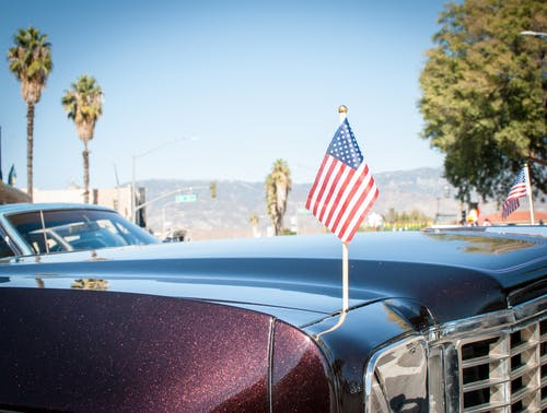 Free stock photo of american flag, car, palm tree