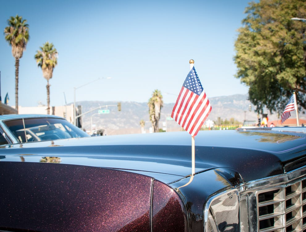 Free stock photo of american flag, car, palm tree