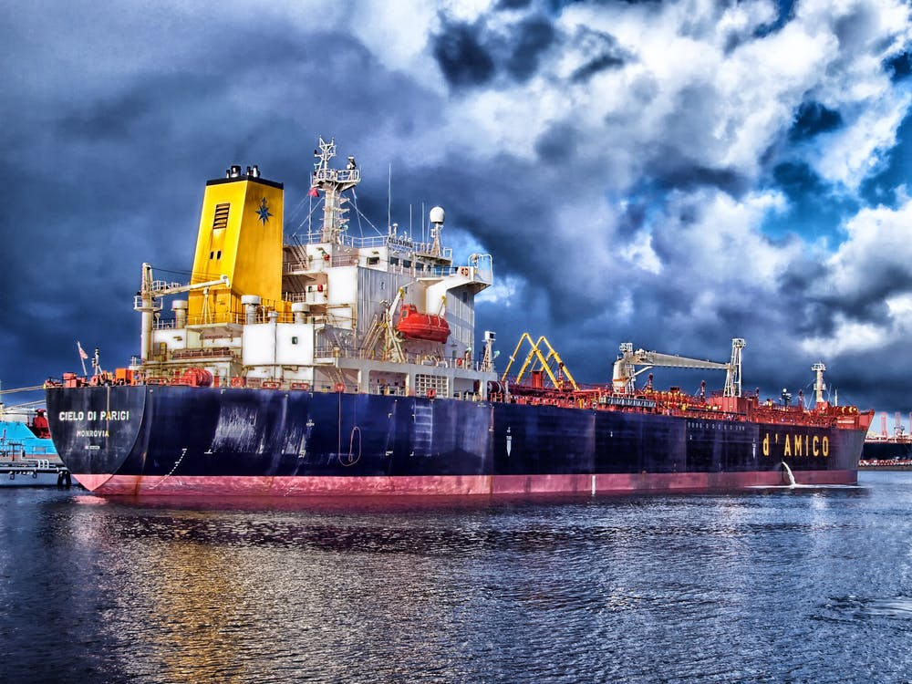 Blue and Grey Cargo Ship Navigating