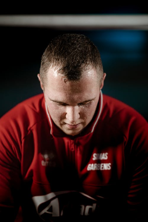 Focused strong sweaty sportsman in gym