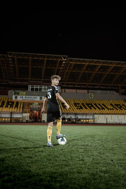 Football player training on field in stadium