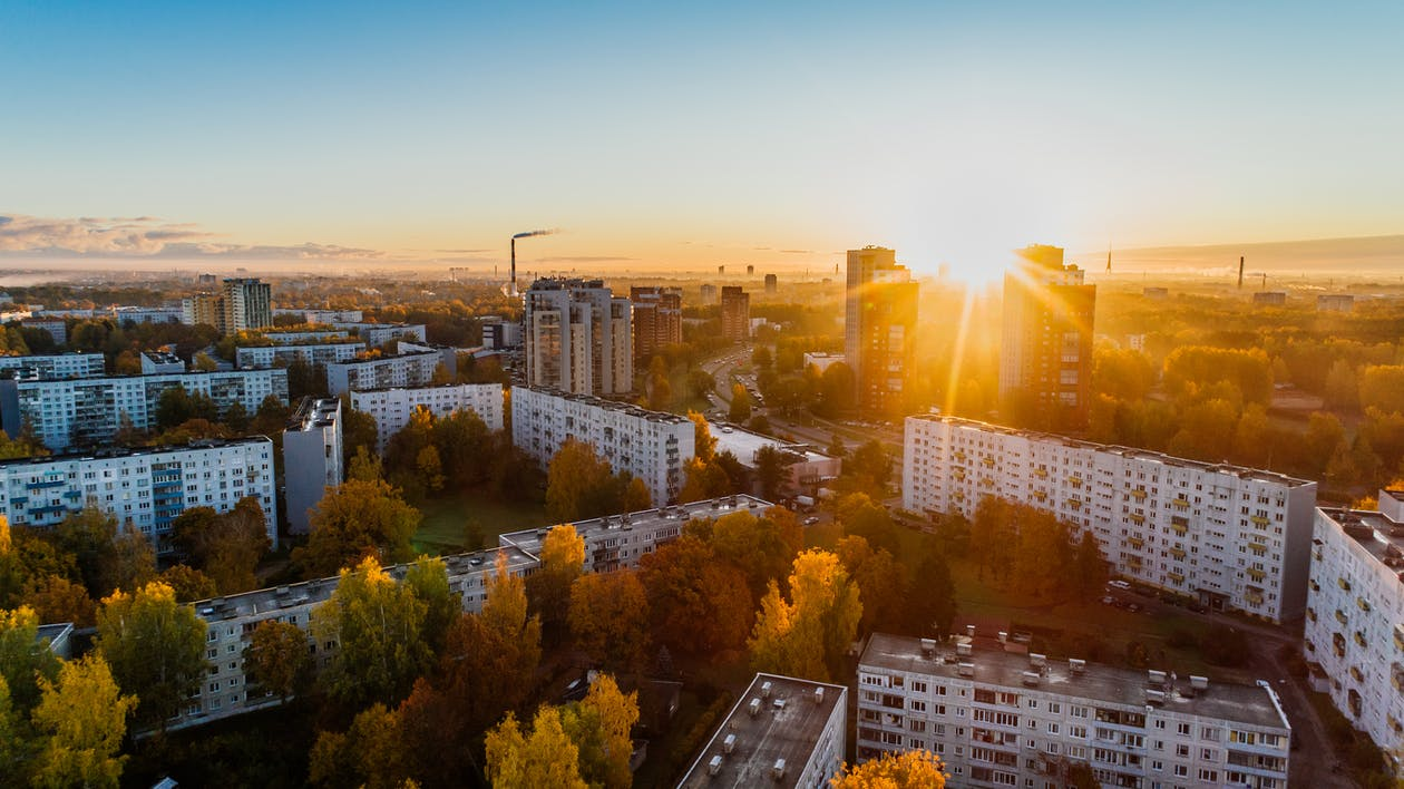Aerial View of White Concrete Buildings during Golden Hours