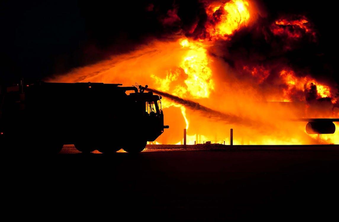 Firetruck Spraying Water on Fire