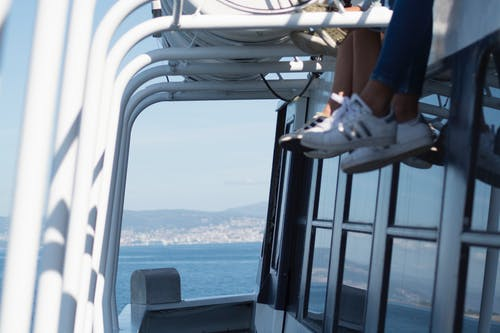 Free stock photo of boat, feet, hang over, sea