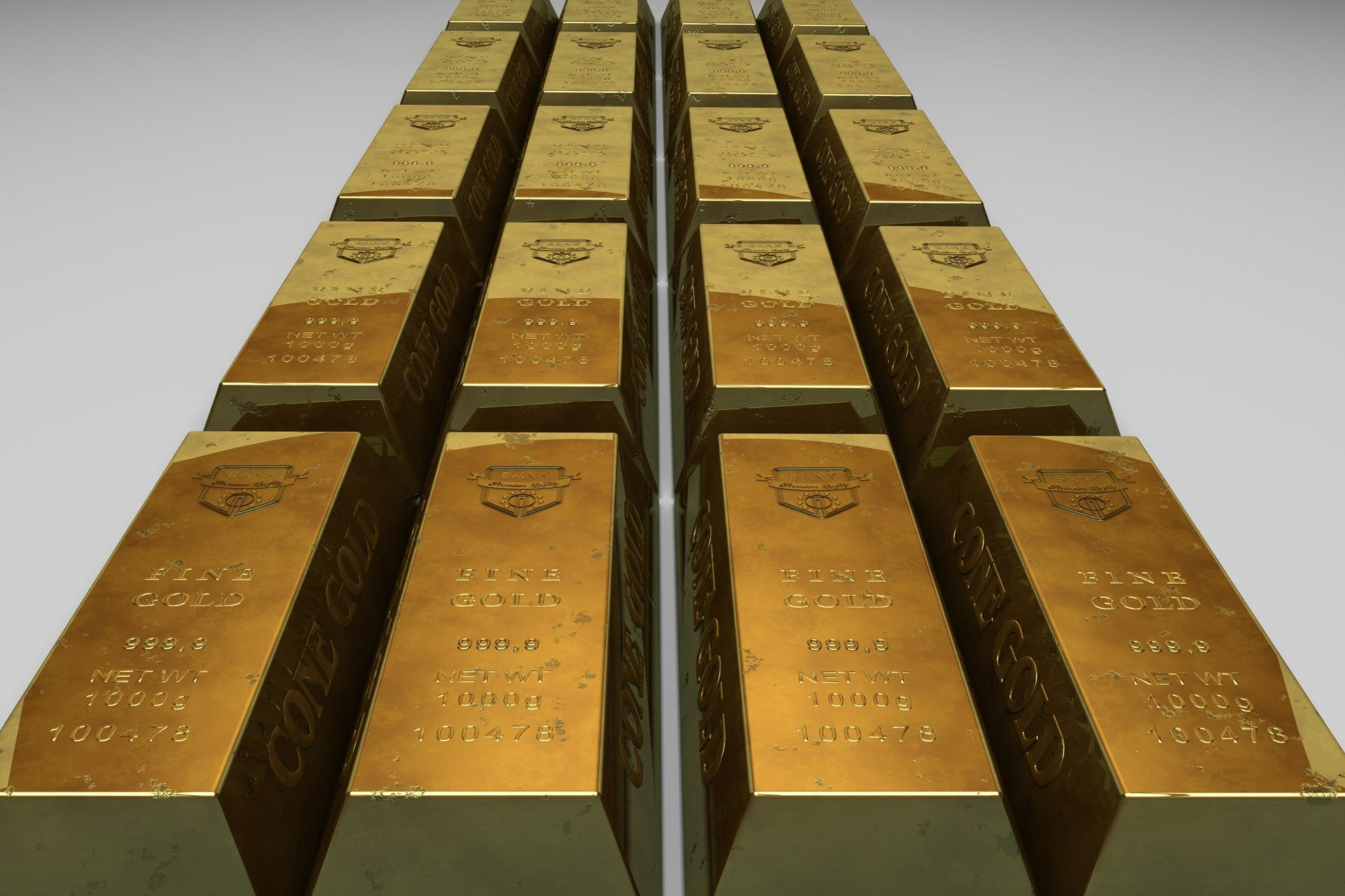 Shallow Focus Photo of Gold Bars