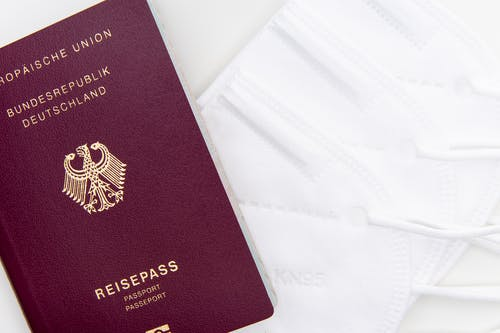 Red and Gold Passport on White Textile