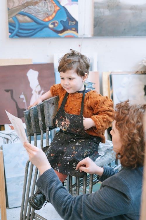 A Boy Looking at His Artwork