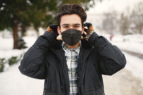 A Man in Black Jacket Wearing a Face Mask