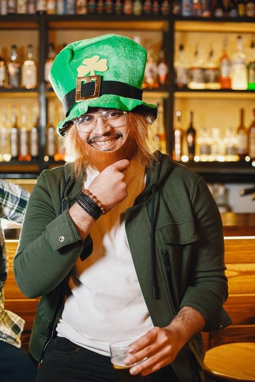 A Man Wearing a Leprechaun Hat