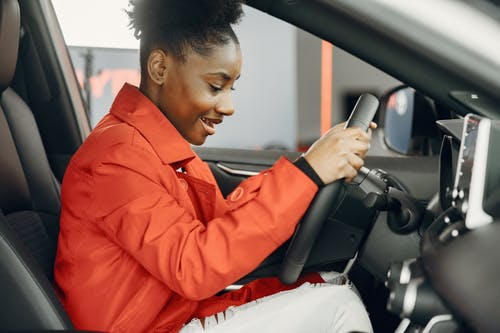 A Young Woman Behind the Steering Wheel