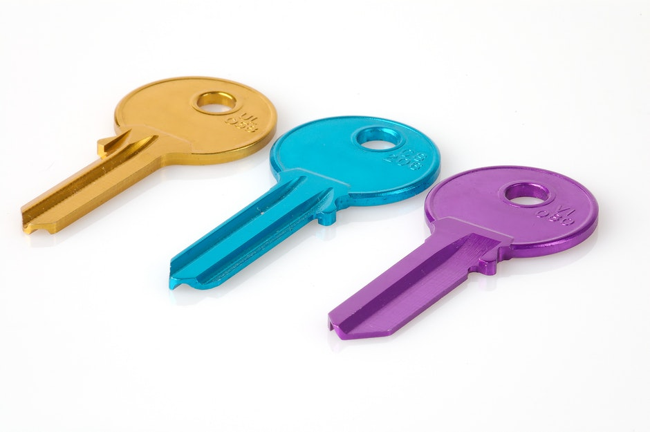 Three Keys in a White Background Photo