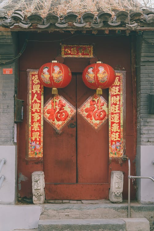 Chinese Lanterns and Posters on a Red Door
