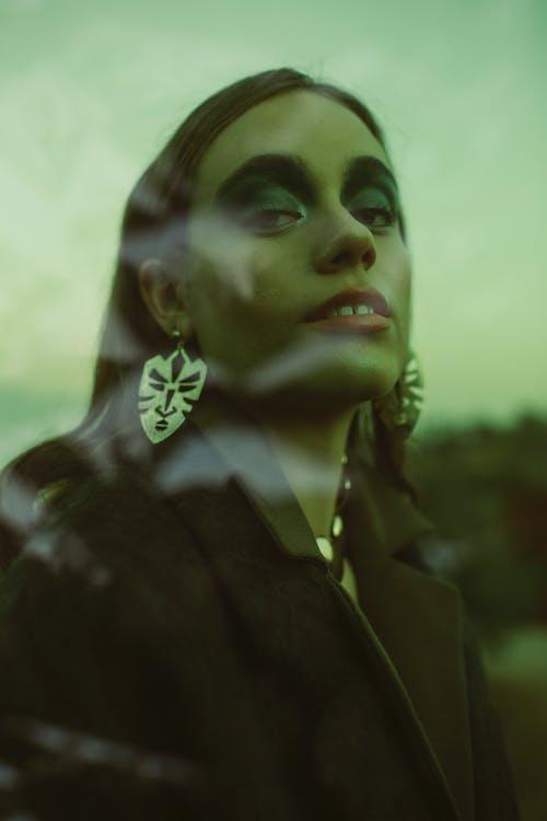 Woman Wearing Black Coat and Silver Earrings