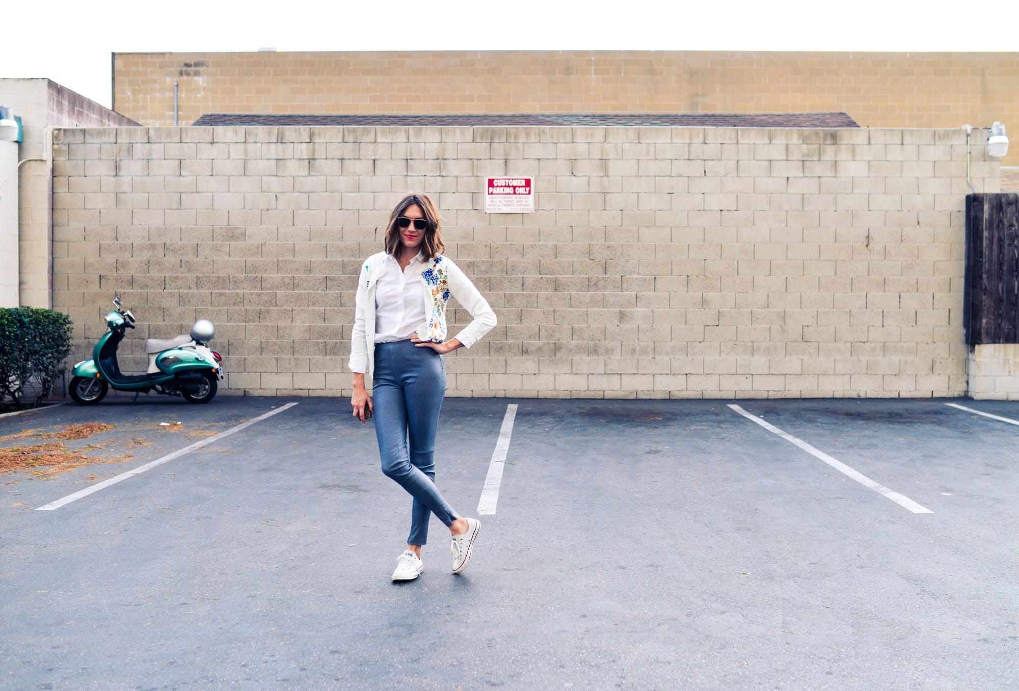 Woman Standing in Empty Parking Area