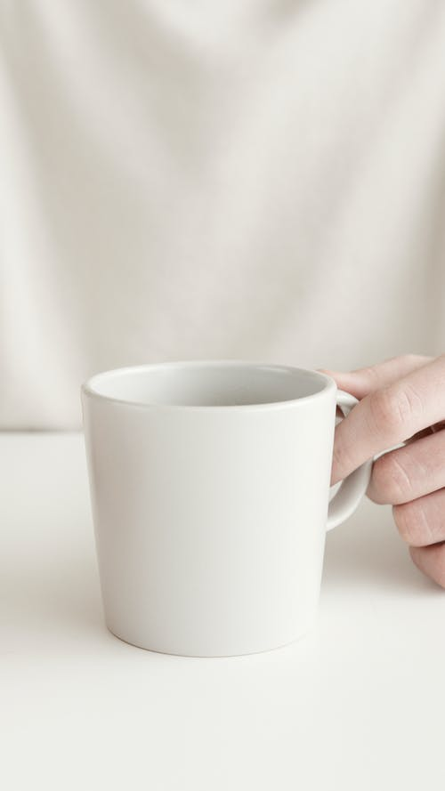 Person Using White Cup
