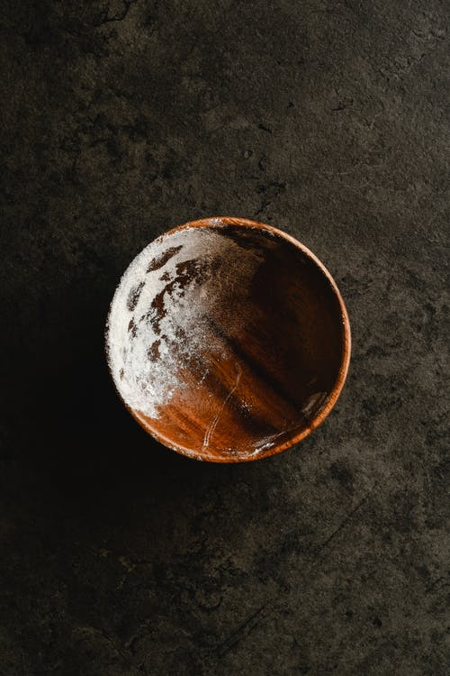 Overhead Shot of a Wooden Bowl with Flour