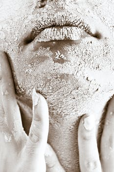 Person's Face Covered With White Powder