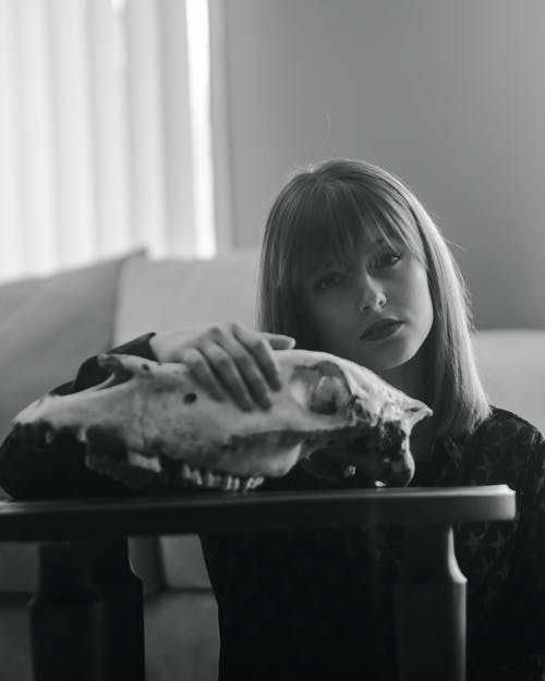 Grayscale Photo of Girl Holding a Piece of Bread