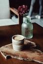 Brown Cup on Brown Wood Slab