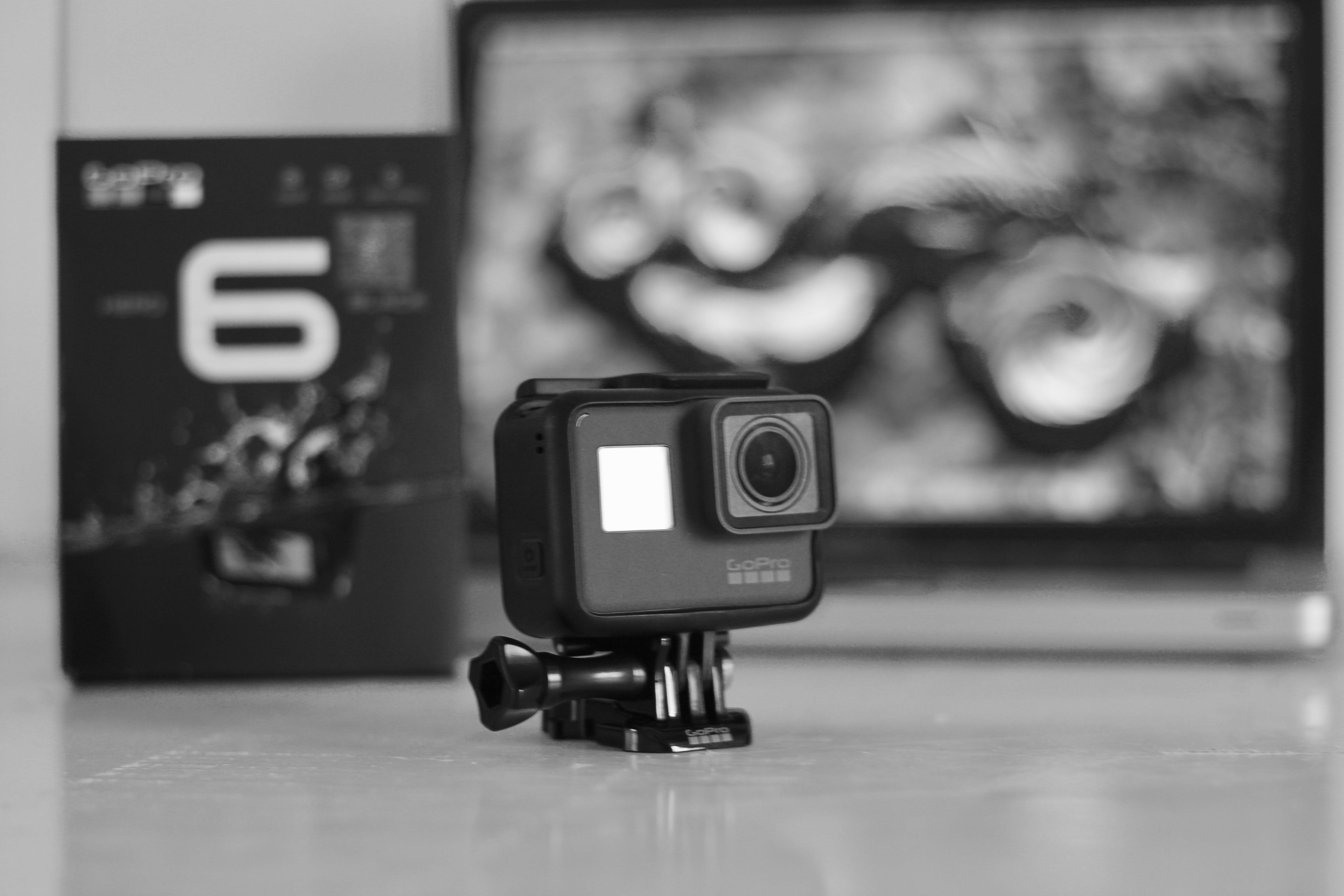 Free stock photo of action camera, black and white, black background, camera