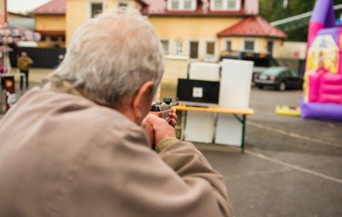 Free stock photo of dad, grandfather, gun, people
