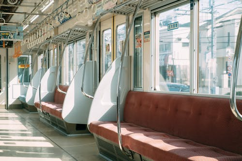 Empty contemporary train in city on sunny day